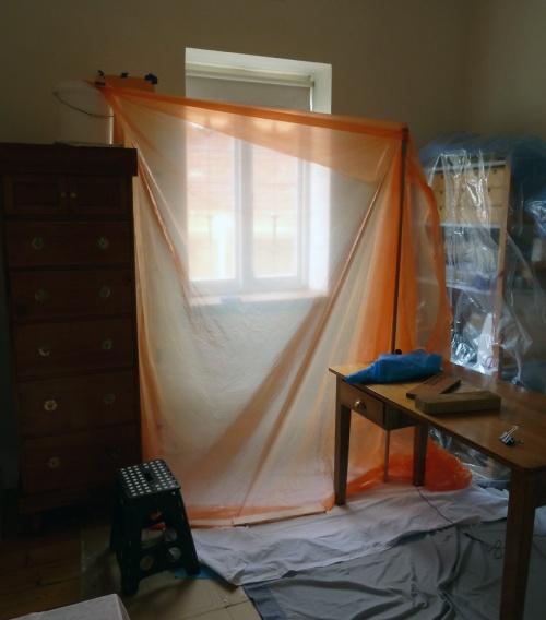 sanding prep work in second bedroom