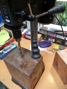 vertical drill press and wood block