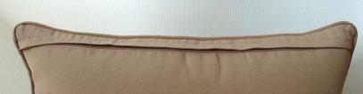 zip detail on brown cushion cover