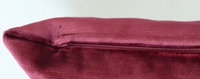 zip detail on crimson cushion cover
