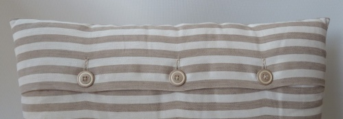 button detail on striped cushion cover